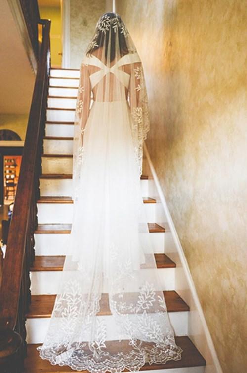 الطرحة الطويلة لعروس ممشوقة