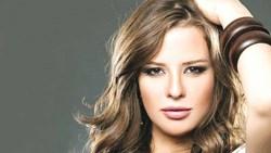 الفنانة إيمان العاصي تفجع في والدها